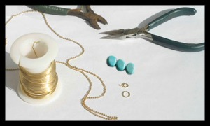 Jewellery chain, blue beads and connecting rings.